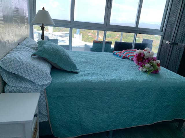 second bedroom, brand new high end Queen bed, lovely ocean and mountain views.