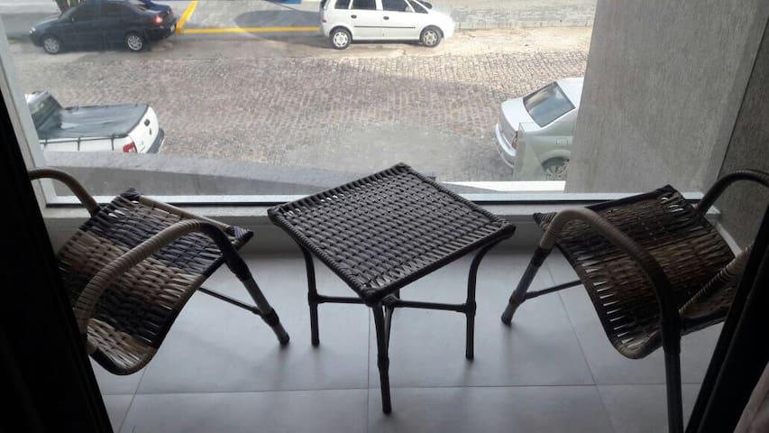 Varanda com mobiliário