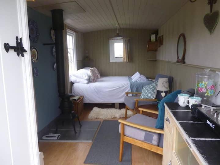 Shepherd's Hut; woodburner, double bed, toilet.
