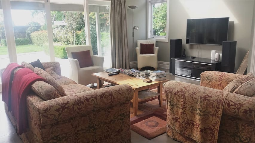 Comfortable and relaxed seating in the Guest Lounge with large 1.2m TV and NetFlix. Lovely garden access and views.