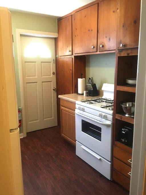 Fully equipped kitchen with stove, microwave, oven, full fridge, coffee maker, utensils, cookware etc...