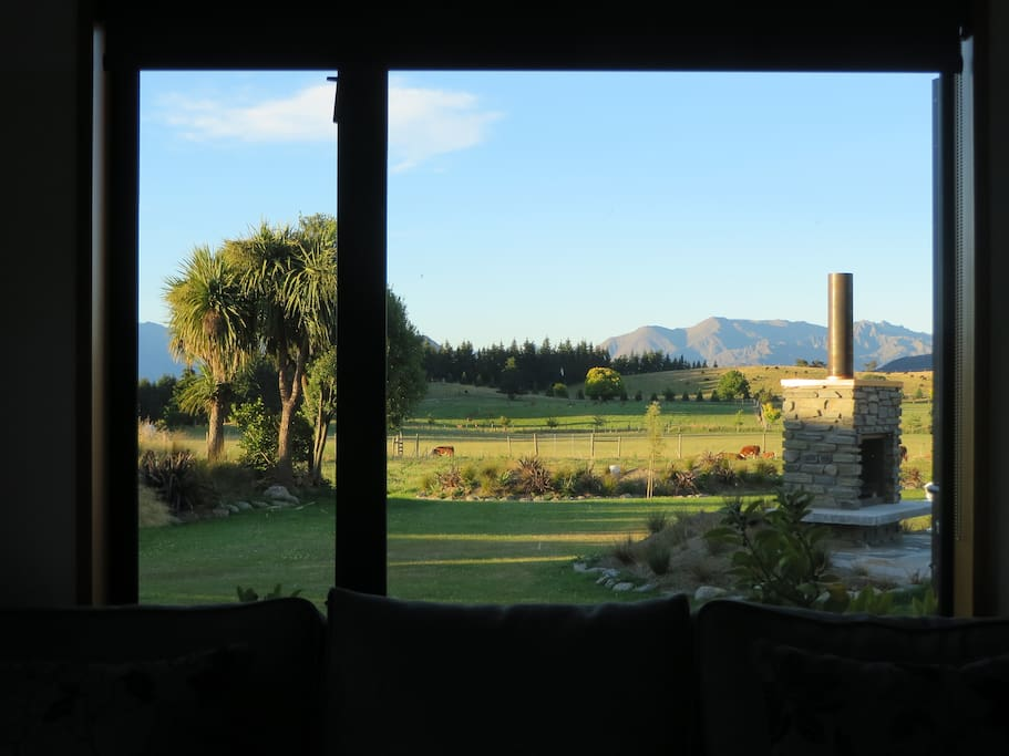 view from bed out to garden and mountains