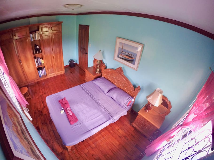 Bedroom with queen size bed, available closet space, air condition with both windows that overlooks the rice fields.