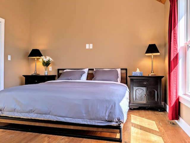 Master bedroom with a King Bed, Ensuite Bathroom and a Smart TV.