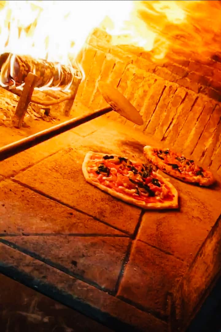 Baking pizza in wood fired oven
