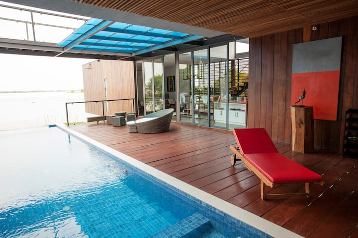 Modern Wooden Home on the Banks of the Mekong