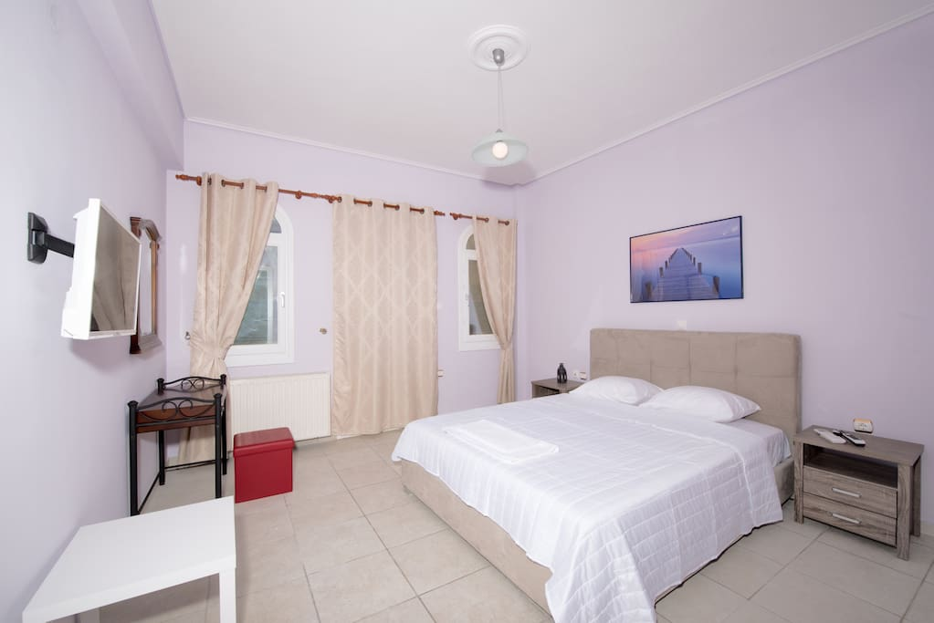 Airconditioned room with king sized bed, satelite Tv and  a private balcony.