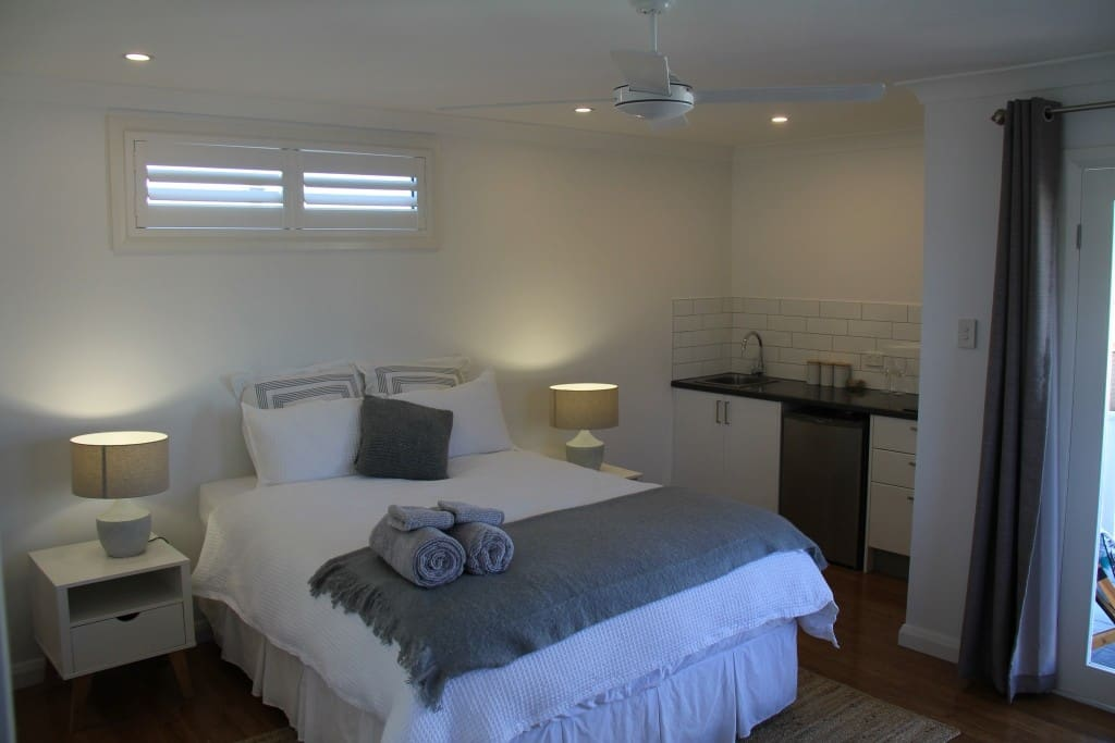 Luxurious queen bed and kitchenette