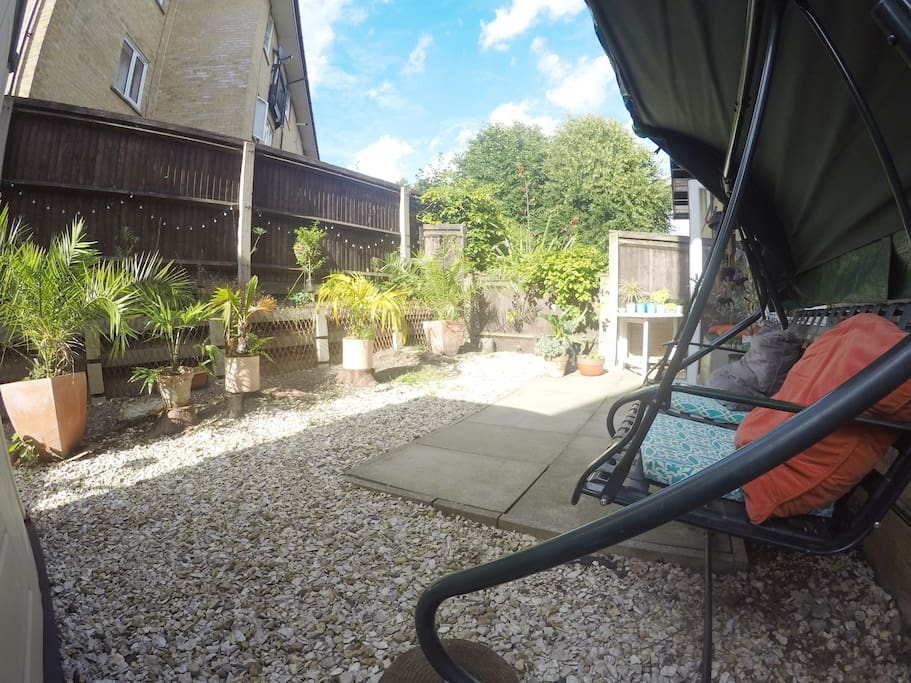 Spacious Back Garden with Swing Bench, Dining Table & BBQ
