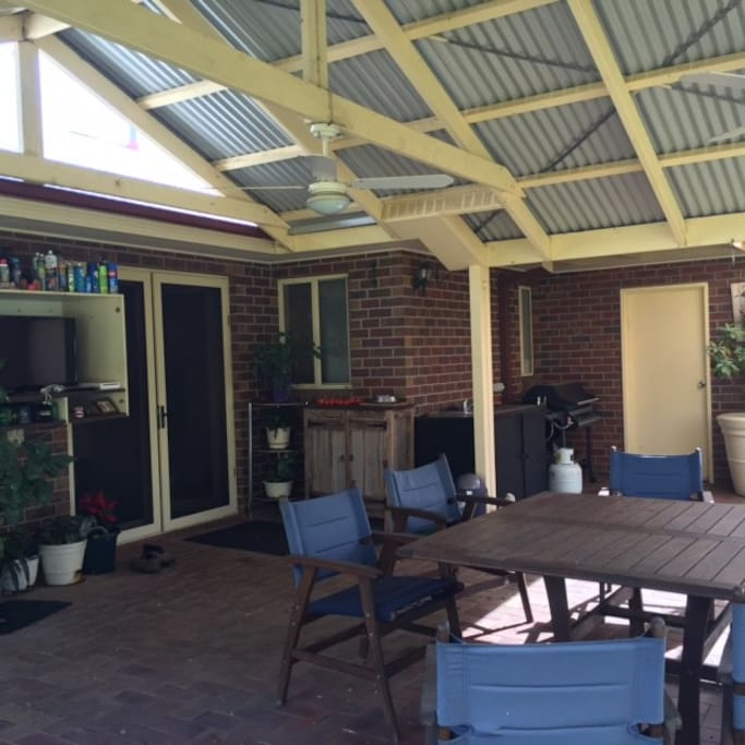 BBQ, outdoor television, eating area & ceiling fans