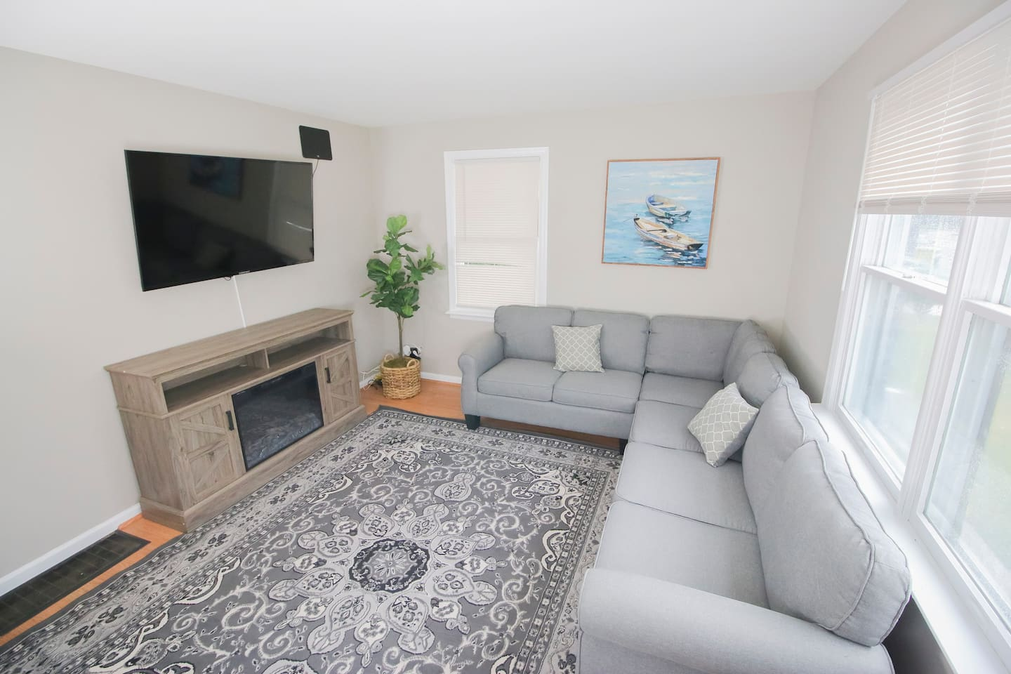 Cozy living room with wall mounted TV.