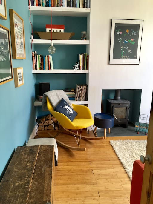 Living room with woodburner, record player, rocking chair and optional toys