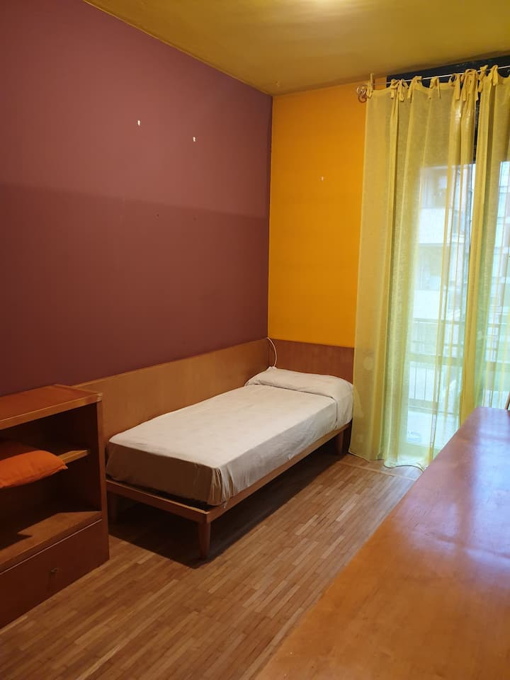 A single room with a balconi.