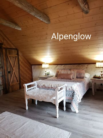 """Spacious """"Alpenglow"""" guest room with private balcony."""