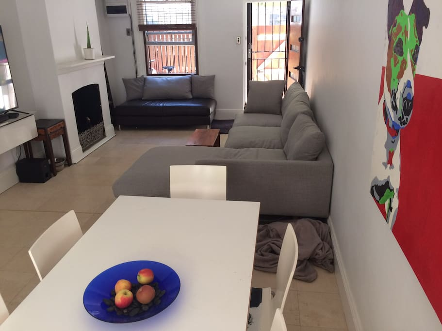 Open dining / lounge area featuring a bowl with apples...