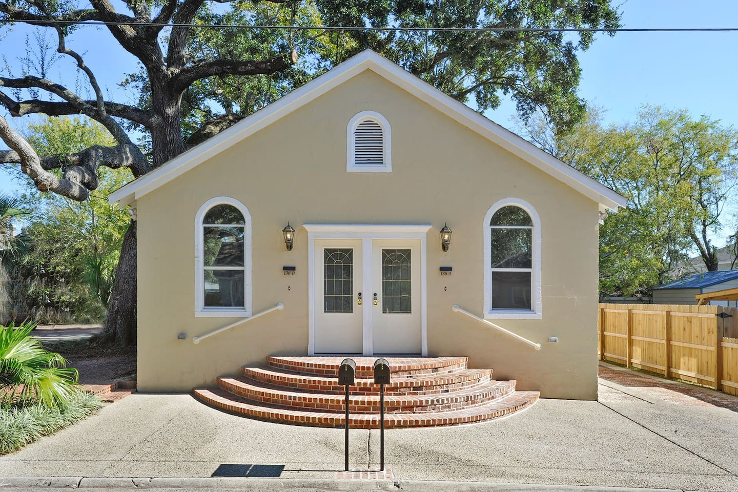 Walk to the casinos, beach and downtown Biloxi!  Come and enjoy the charm of this completely  remodeled Historic home.  This home is a combination of 2 units that give your group a total of 4 bedrooms, 4 bathrooms, 2 living areas and 2 kitchens.  There is also a sleeper sofa and a fold away single bed - just in case.  :-)  Walk 2 blocks to the beach, 1 1/2 blocks to the new library, and 2-5 blocks to several of the best restaurants in Biloxi.  The casinos are a short walk away, too!
