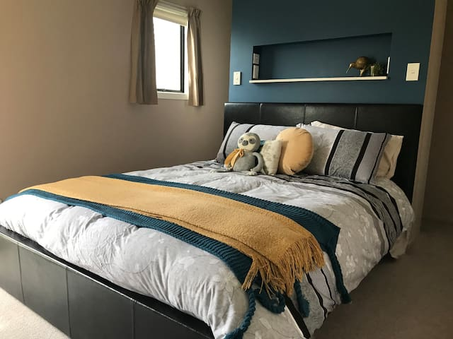 Queen size bed with extra blankets available.  A walk around wardrobe is behind the bed with coat hangers and shoe rack