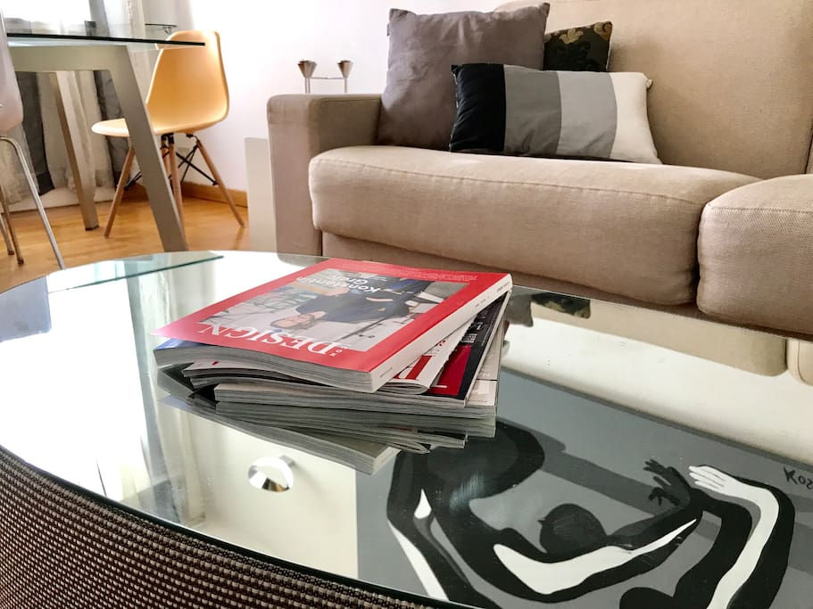 Natuzzi mirror coffee table in front of the sofa bed