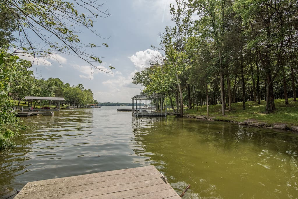 Your lush yard is nestled steps from the shore of Old Hickory Lake.