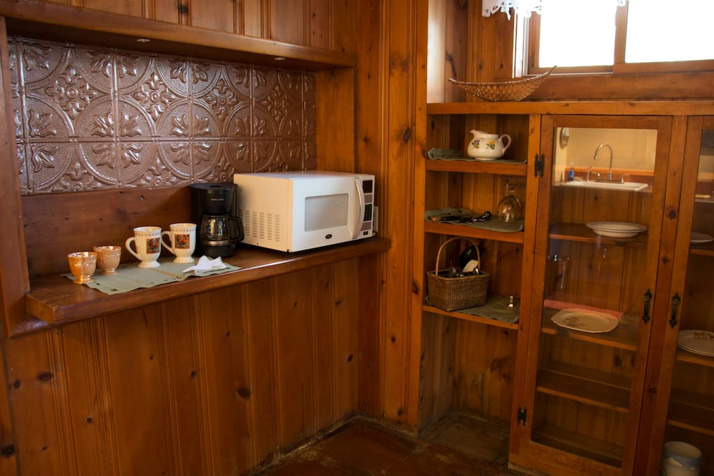 Well appointed kitchenette features microwave, coffee maker, refrigerator and dish-ware.