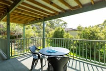Covered Deck overlooking yard Gate has bolt to look. Apartment Enrty is here.