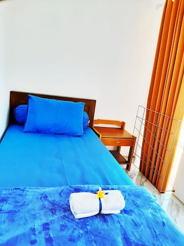Bed room with single bed and air conditioner