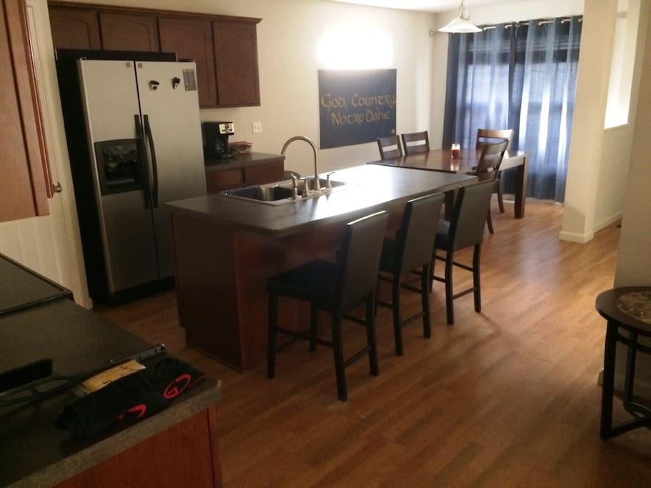 Large kitchen with all cooking supplies, large dining rom table and breakfast bar seating.