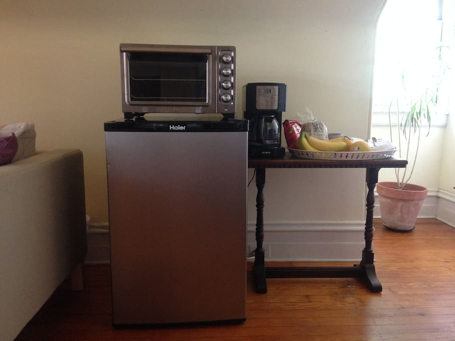 Mini-fridge, toaster, coffee maker, and some various treats for you! (treats may vary!)