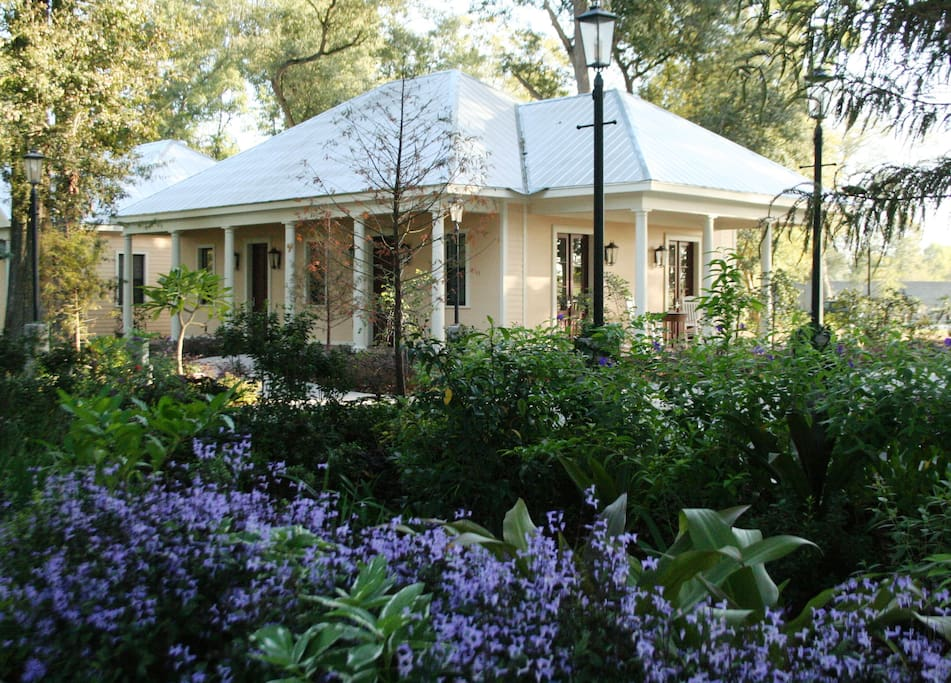 Lush gardens and lighted walking paths surround the cottages
