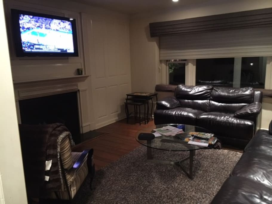 """Casual Den with 42"""" TV and 2 large couches"""