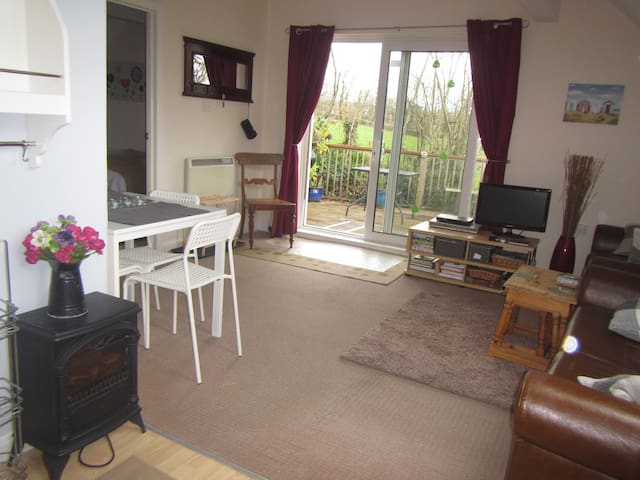 Dining table, sofa, TV and DVD, access to deck