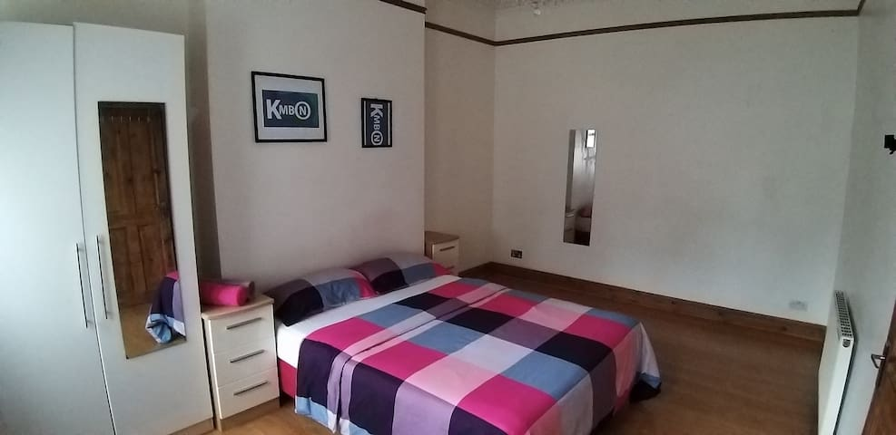 Clean large modern bed room with king size bed