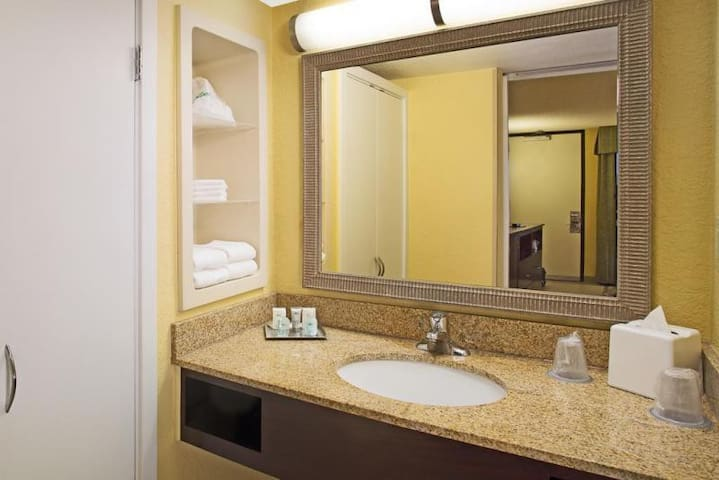 Full bathroom includes fresh linens provided daily