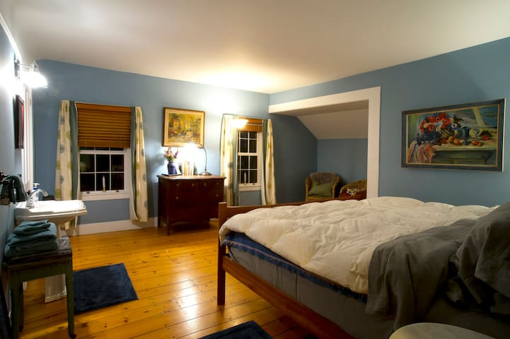 King size bed with soft flannel sheets, wool blankets and down comforter, private bathroom .