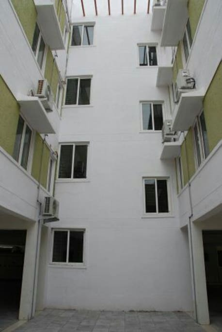 Just three floors and each floor having only 2 apartments; No shared wall.