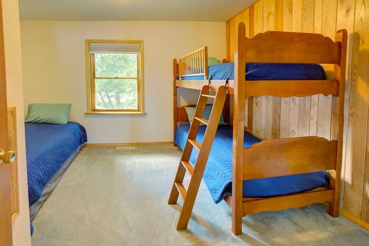 Bunk Room with 3 twin beds sleeps 3 people.