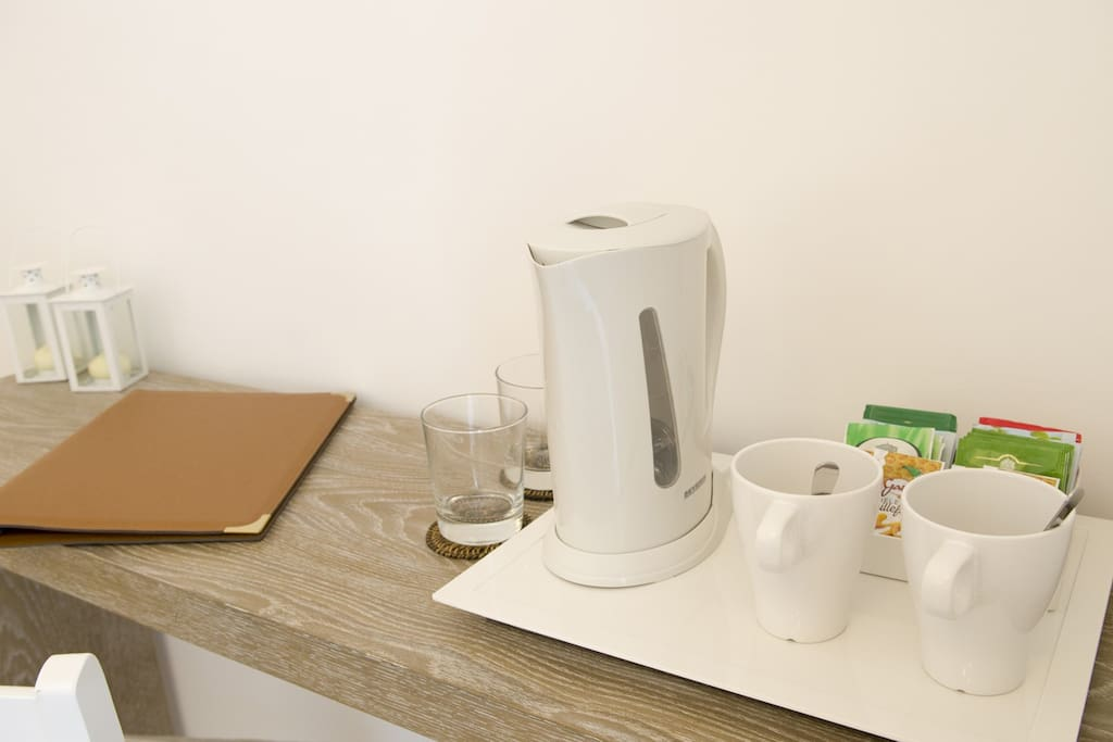 Tray with kettle and selection of herbal teas and instant coffee