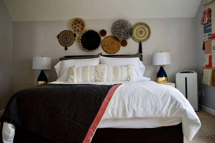 Bedroom 2 with queen-sized mattress. Enjoy the sunset in this relaxing boho inspired bedroom.