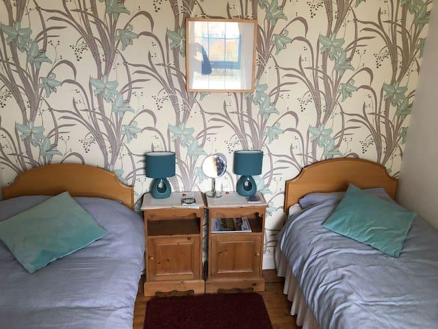 Twin double bedroom.
