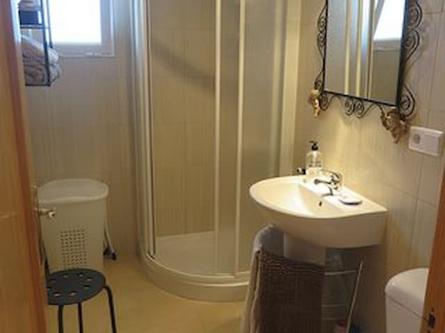 Shower Room,  just a step outside the bedroom door and has a cubicle shower hand basin and shower.