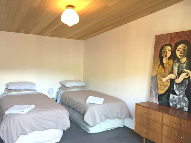 Large bedroom with 2 wardrobes that can be set up as a superking or 2 singles