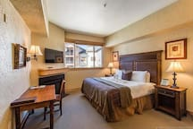 King suite at the Silverado Lodge. Includes flatscreen TV, fireplace, desk, king bed with luxurious linens, refrigerator, microwave, coffee maker and more!  (Old original bedding:( LOL) New fresh luxurious bedding now!!