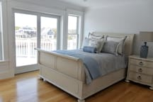 Bedroom with full bed, slider to deck, private bathroom
