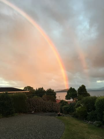 A brilliant show of a rainbow from the deck
