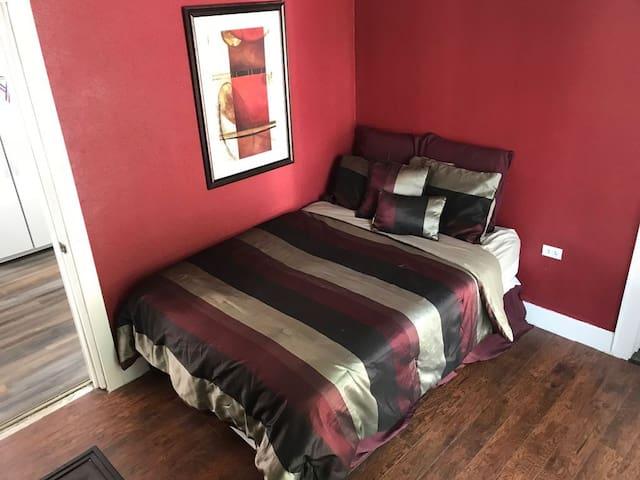 Main floor bedroom with Queen bed.