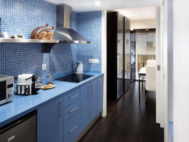 Suite Blau Apartment Kitchen area & Welcome Pack which is an Italian breakfast of coffee, tea and cereal biscuits.