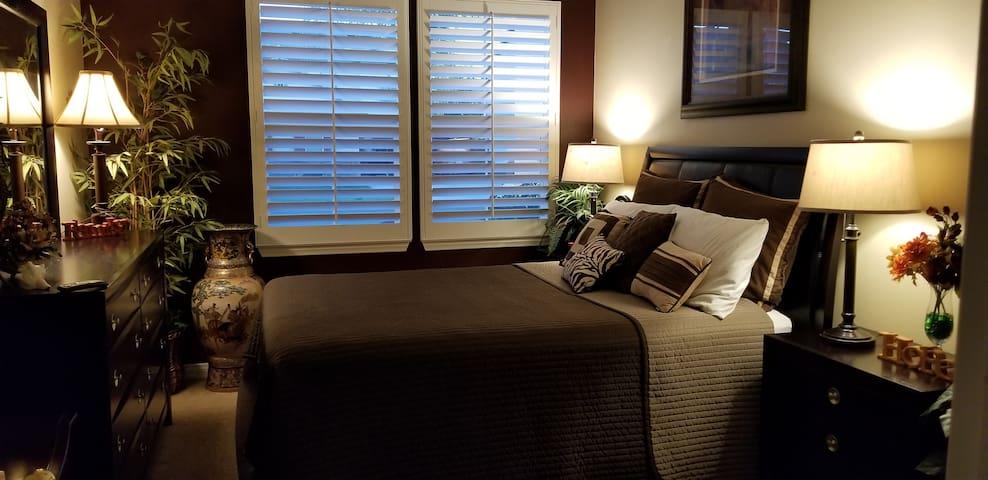 Bedroom with queen bed downstairs