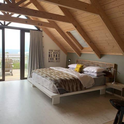 Main bedroom.Freestanding bath with great views across False Bay.