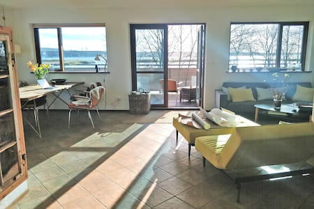 Beautiful waterfront apartment in the park