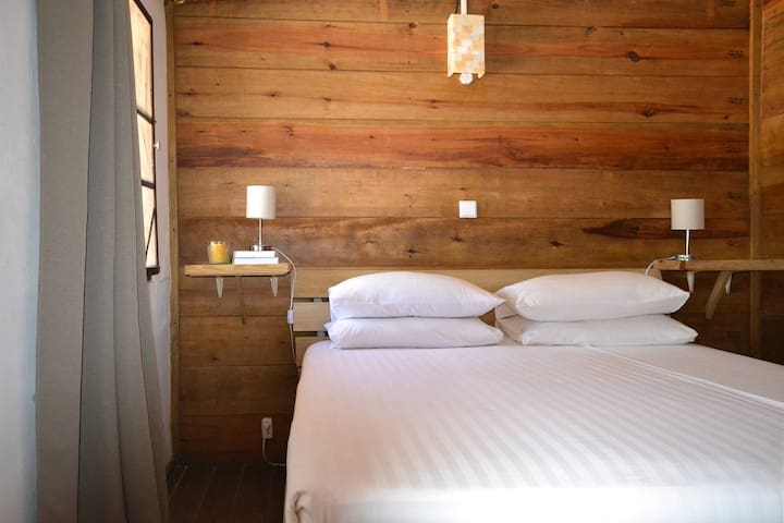 The apartment offers two bedrooms. One with double bed and air-conditioning. The other one with two single beds and ventilators. The apartment has shutter windows (with insect screens) and the ever blowing breeze offers a comfortable cool atmosphere.